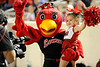 Lamar Cardinal mascot and young fan pose for the camera at Provost Umphrey Stadium Saturday night. Photo by Drew Loker.