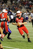 Lamar Cardinal's Caleb Berry, 12, looks for a receiver at Provost Umphrey Stadium Saturday night. Photo by Drew Loker.