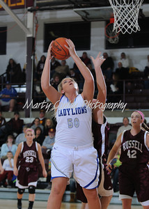 Savannah Anderson of Lewis County pulls down an offensive rebound against Russell.