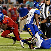 West Brook Bruin Demarcus Smith, 3, scrambles out from a pack of Ozen Panthers and heads to the end zone at the Carroll Thomas Stadium Friday night. Photo by Drew Loker.