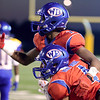 West Brook Bruin Keith Corbin, 1, assists Will Gavrelos, 4, after a nice reception but landing hard on the ground at the Carroll Thomas Stadium Friday night. Photo by Drew Loker.