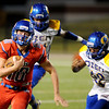 West Brook Bruin Justin Essex, 10, keeps the ball for a short run with Ozen Panther Sarkeithan Thomas, 42, closing in at the Carroll Thomas Stadium Friday night. Photo by Drew Loker.