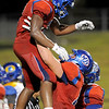 West Brook Bruins celebrate after Demarcus Smith, 3, coasted into the endzone against the Ozen Panthers at the Carroll Thomas Stadium Friday night. Photo by Drew Loker.