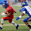 The Ozen Panther Michale Banks, 11, tries to run down West Brook Bruin Will Gavrelos, 4, at the Carroll Thomas Stadium Friday night. Photo by Drew Loker.