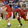 West Brook Bruin Justin Essex looks to the sideline with Demarcus Smith, 3, in motion at the Carroll Thomas Stadium Friday night. Photo by Drew Loker.