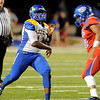 Ozen Panther Josh Boyd, 14, passes under pressure from the West Brook Bruins at the Carroll Thomas Stadium Friday night. Photo by Drew Loker.