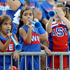 Emma Rojas, Elizabeth Rojas, and Melanie Brewer get ready to cheer at the Carroll Thomas Stadium Friday, Sept 19, 2014. Photo by Drew Loker.