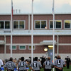 Referees prepare for the start of the game between the West Brook Bruins and the Taylor Mustangs at the Carroll Thomas Stadium Friday, Sept 19, 2014. Photo by Drew Loker.
