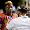 West Brook Bruin Isaac Aubrey, 2, talks to his coach during the match up against the North Shore Mustangs at the Carroll Thomas Stadium September 26, 2014. Photo by Drew Loker.