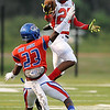 West Brook Bruin Corry McGill, 23, tries to block a reception by the North Shore Mustang at the Carroll Thomas Stadium September 26, 2014. Photo by Drew Loker.