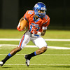 West Brook Bruin Kortlin Grant, 12, looks for room to run against the North Shore Mustangs at the Carroll Thomas Stadium September 26, 2014. Photo by Drew Loker.