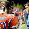 West Brook Bruin Corry McGill, 23, talks to the pressbox coaches during match up against the North Shore Mustang at the Carroll Thomas Stadium September 26, 2014. Photo by Drew Loker.