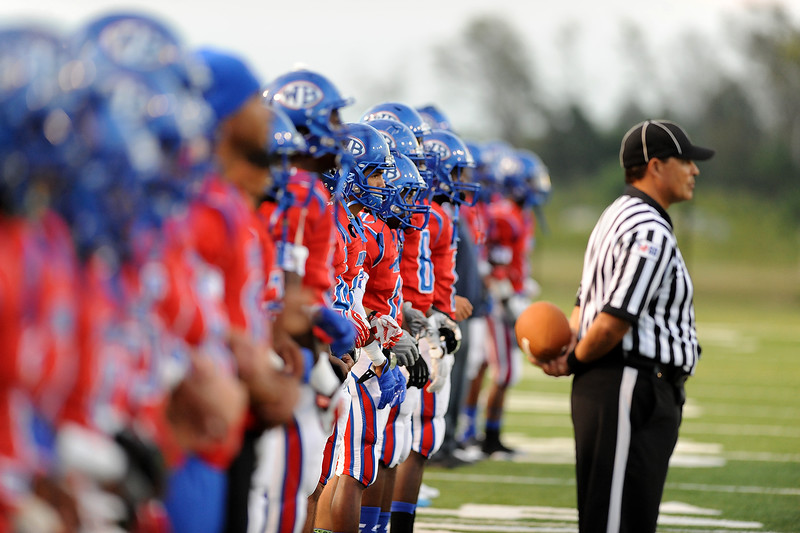 West Brook Bruin preapre to take the field during the match up against the North Shore Mustangs at the Carroll Thomas Stadium September 26, 2014. Photo by Drew Loker.