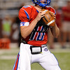 West Brook Bruin Justin Essex, 10, looks for an open receiver during the match up against the North Shore Mustangs at the Carroll Thomas Stadium September 26, 2014. Photo by Drew Loker.