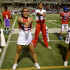West Brook Bruins cheerleaders pep up the crowd during the match against the North Shore Mustangs at the Carroll Thomas Stadium September 26, 2014. Photo by Drew Loker.