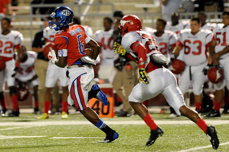 West Brook Bruin Innis Gaines, 6, makes for a nice gain after an interception from the North Shore Mustangs at the Carroll Thomas Stadium September 26, 2014. Photo by Drew Loker.