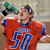 West Brook Bruin Greg Saleme, 50, takes a water break during the match up against the North Shore Mustangs at the Carroll Thomas Stadium September 26, 2014. Photo by Drew Loker.