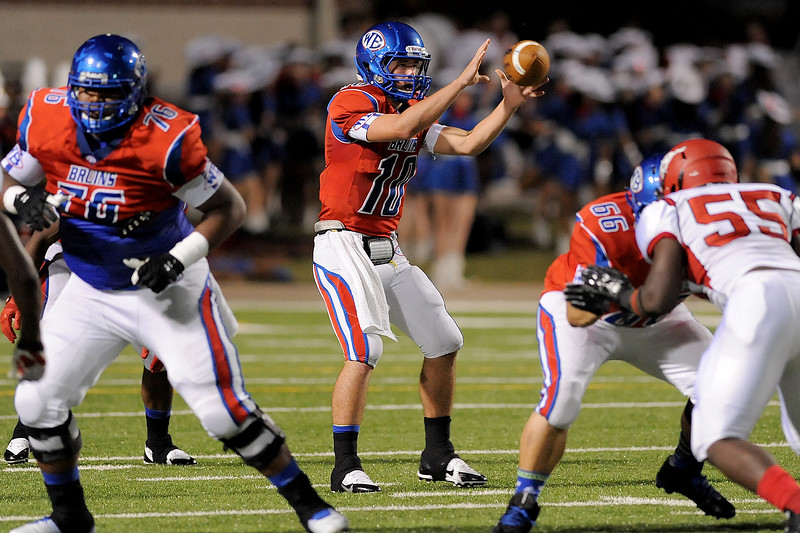 West Brook Bruin Justin Essex, 10, trys to score before halftime during the match up against the North Shore Mustangs at the Carroll Thomas Stadium September 26, 2014. Photo by Drew Loker.