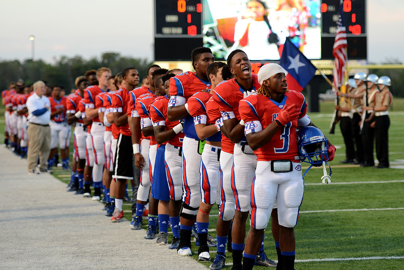 The West Brook Bruins participate in the pregame anthem before the match up against the North Shore Mustangs at the Carroll Thomas Stadium September 26, 2014. Photo by Drew Loker.