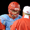 Lumberton Raider Stephen Yarbro, 10, talks with his coach at Lumberton High School October 3, 2014. Photo by Drew Loker