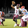 Central Jaguar Michael Jacquet, 7, looks for open receiver aginst the Lumberton Raiders at Lumberton High School October 3, 2014. Photo by Drew Loker