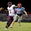 Central Jaguar Michael Jacquet, 7, looks for open receiver with Lumberton Raider Keifer Rains, 50, closing at Lumberton High School October 3, 2014. Photo by Drew Loker