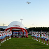 Phantom Quadcopter hovers over the Lumberton Raiders as they prepare to take the filed.