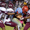 Lumberton Raider Caleb Thomas, 33, is stopped by a host of Central Jaguars at Lumberton High School October 3, 2014. Photo by Drew Loker