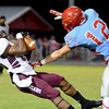 Central Jaguar Haverly Kendrick, 24, comes down with an interception with a pass intended for Lumberton Raider Brenner Boykin, 12, at Lumberton High School October 3, 2014. Photo by Drew Loker