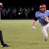 Lumberton Raider Tim Rhodes, 7, runs with a kickoff return aginst the Central Jaguars at Lumberton High School October 3, 2014. Photo by Drew Loker