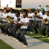 Central Jaguar Alumni perform before the homecoming game against the Vidor Pirates at the Carroll Thomas Stadium October 24, 2014. Photo by Drew Loker