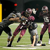 Central Jaguar Carnell Seals, 5, runs into Vidor Pirate Andy Laughlin, 44, and Kolby Humble, 5, at the Carroll Thomas Stadium October 24, 2014. Photo by Drew Loker
