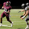 Central Jaguar Devwah Whaley, 12, finds room room to run against the Vidor Pirates at the Carroll Thomas Stadium October 24, 2014. Photo by Drew Loker