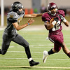 Central Jaguar Devwah Whaley, 12, evades Vidor Pirate Tyler Willis, 14, at the Carroll Thomas Stadium October 24, 2014. Photo by Drew Loker