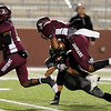 Central Jaguar Devwah Whaley, 12, collides with Vidor Pirate Bret Hall, 10, at the Carroll Thomas Stadium October 24, 2014. Photo by Drew Loker