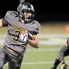 Vidor Pirate Haylon Leckelt, 3, runs for a short gain against the Central Jaguars at the Carroll Thomas Stadium October 24, 2014. Photo by Drew Loker