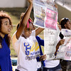 Aryss Harper (white shirt) peaks under the paper as she and fellow Ozen Panther cheerleaders show a lack of interst as the Central Jaguar band plays across the field at the Carroll Thomas Stadium October 17, 2014. Photo by Drew Loker