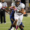 Central Jaguar Devwah Whaley, 12, carries the ball against the Ozen Panthers at the Carroll Thomas Stadium October 17, 2014. Photo by Drew Loker