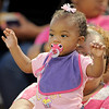 Tina LaDay, Ozen Panther fan, holds young Joniyah Barabin as she shows her enthusiasm for the match agaisnt the Central Jaguars at the Carroll Thomas Stadium October 17, 2014. Photo by Drew Loker