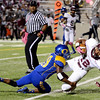 Central Jaguar Devwah Whaley, 12, flys into the endzone with Ozen Panther Edward Adams, 19, trying to prevent the score. This was shortly after Central recovered it's own fumble for additional yardage at the Carroll Thomas Stadium October 17, 2014. Photo by Drew Loker