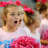 Sallie Curtis students stand in awe as the Ozen Panther Cheerleaders take the field at the Carroll Thomas Stadium October 17, 2014. The young students, led by Amy Rubin, had just performed their own cheers on the field for Cancer Awerenesss Month activities. Photo by Drew Loker