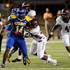Ozen Panther quaterback Josh Boyd, 14, under pressure from the Central Jaguars looks for an open receiver at the Carroll Thomas Stadium October 17, 2014. Photo by Drew Loker