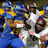 Ozen Panther quaterback Josh Boyd, 14, keeps the ball and pushes for yardard against the Central Jaguars at the Carroll Thomas Stadium October 17, 2014. Photo by Drew Loker
