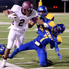 Central Jaguar Exavier Jones, 2, after a nice gain is run out of bounds by Ozen Panther Deonte Darjean, 7, at the Carroll Thomas Stadium October 17, 2014. Photo by Drew Loker