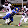 Central Jaguar Kendrick Haverly, 24, tries to dodge an Ozen Panther at the Carroll Thomas Stadium October 17, 2014. Photo by Drew Loker