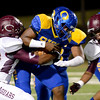 Ozen Panther quaterback Josh Boyd, 14, is held back by a Central Jaguar at the Carroll Thomas Stadium October 17, 2014. Photo by Drew Loker