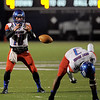 West Brook Bruin QB Justin Essex, 10, takes the snap from Demarcus Smith, 3, on 4th and 4 against the Manvel Mavericks at the Stallworth Stadium in Baytown November 14, 2014. Photo by Drew Loker.