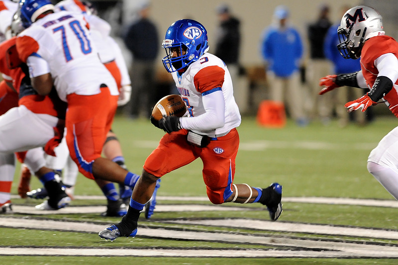 West Brook Bruin Demarcus Smith, 3, maneuvers for an opening against the Manvel Mavericks at the Stallworth Stadium in Baytown November 14, 2014. Photo by Drew Loker.