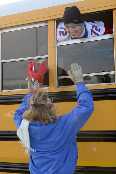 West Brook Bruin mom of Ethan Cothen, 72, says goodbye as her son prepares to depart for the match against the Manvel Mavericks at the Stallworth Stadium in Baytown November 14, 2014. Photo by Drew Loker.
