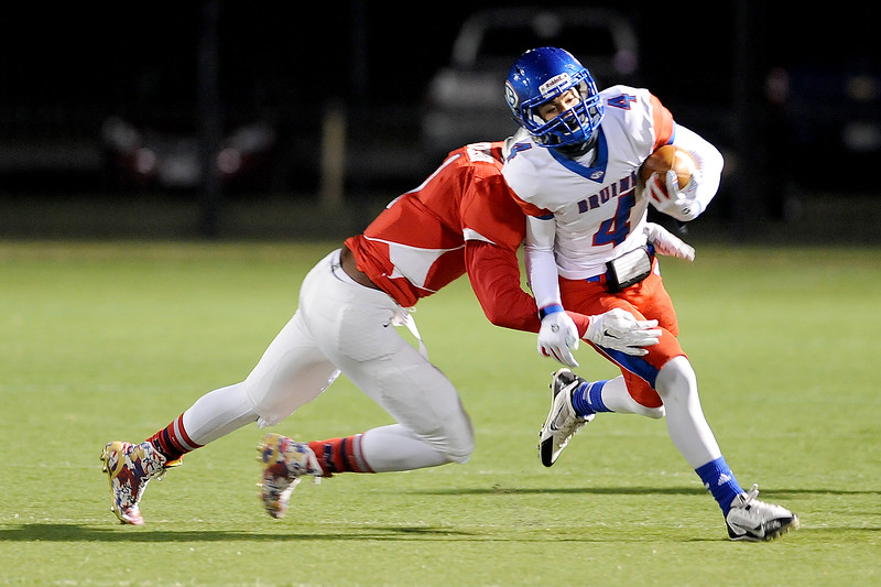West Brook Bruin Will Gavrelos, 4, runs for again after a screen pass against the Manvel Mavericks at the Stallworth Stadium in Baytown November 14, 2014. Photo by Drew Loker.